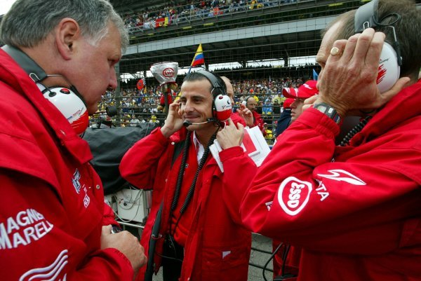 (L to R): Norbert Kreyer (GER) Senior General Manager of Race and Test Engineering, Ange Pasquali (FRA) Toyota Team Manager and Humphrey Corbett (GBR) Toyota Race Engineer on the grid.Formula One World Championship, Rd15, United States Grand Prix, Race Day, Indianapolis, USA, 28 September 2003.DIGITAL IMAGE
