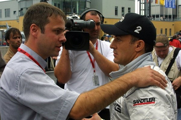 Jean Alesi (FRA) AMG Mercedes is interviewed for television.DTM Championship, Rd6, Lausitzring, Germany. 14 July 2002.DIGITAL IMAGE