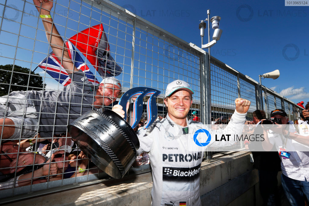 Silverstone, Northamptonshire, England. 30th June 2013. Nico Rosberg, Mercedes AMG, 1st position, shows his trophy to the crowd World Copyright: Charles Coates/  ref: Digital Image _N7T4918