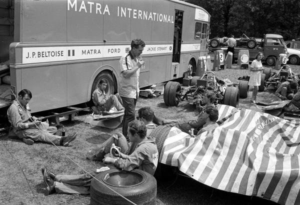 Very basic working conditions for the Tyrrell Matra mechanics as they have their lunch in the Paddock French GP, Clermont Ferrand, 6 July 1969
