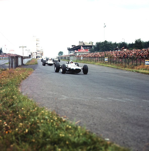 Nurburgring, Germany.30/7-1/8 1965.Bruce McLaren (Cooper T77 Climax) leads Mike Spence (Lotus 33 Climax) and the field.Ref-3/1817.World Copyright - LAT Photographic