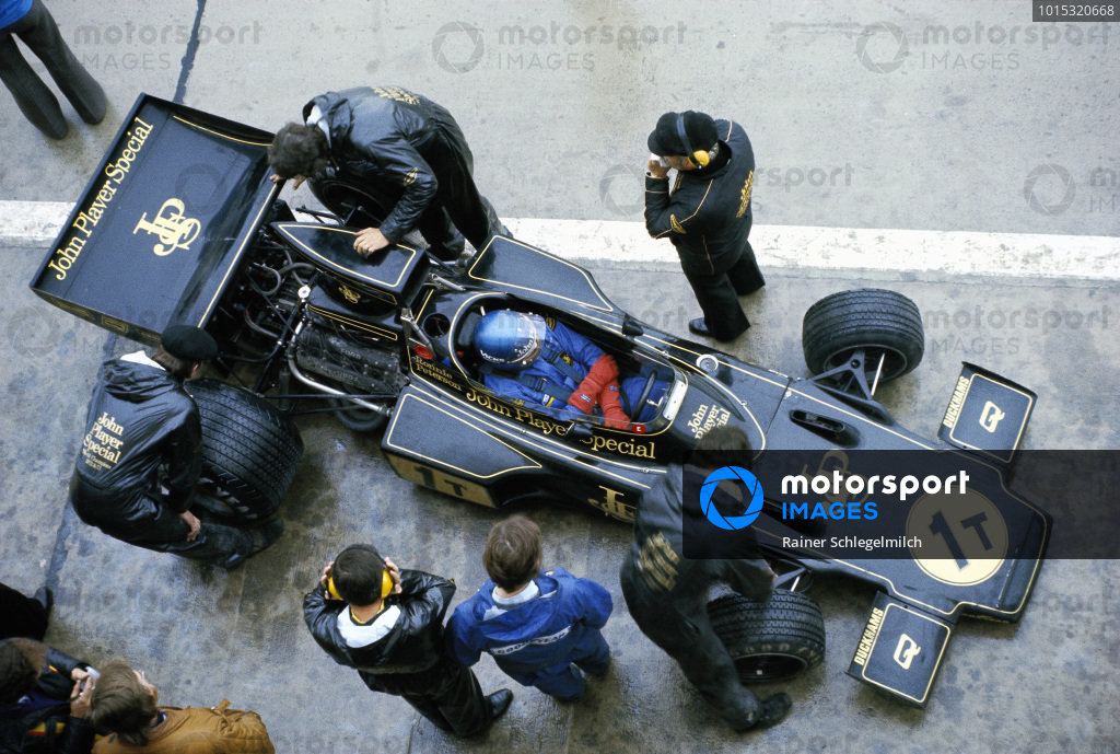 Ronnie Peterson sits in his Lotus 76 Ford during a wet practice session.