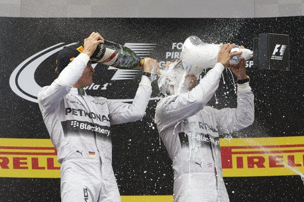 Circuit de Catalunya, Barcelona, Spain. Sunday 11 May 2014. Lewis Hamilton, Mercedes AMG, 1st Position, gets a soaking from Nico Rosberg, Mercedes AMG, 2nd Position. World Copyright: Steve EtheringtonLAT Photographic. ref: Digital Image SNE15376 copy