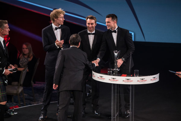 2017 Autosport Awards Grosvenor House Hotel, Park Lane, London. Sunday 3 December 2017. WEC Champions Brendon Hartley, Timo Bernhard and Earl Bamber present the John Bolster award to Pierre Fillon on behalf of the Automobile Club de l'Ouest. World Copyright: Joe Portlock/LAT Images  ref: Digital Image _L5R8915