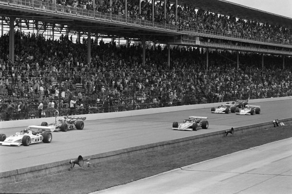 Jerry Grant, All American Racers/Oscar Olson, Eagle 73 Offenhauser, leads Mel Kenyon, Lindsey Hopkins, Eagle 72 Ford, Bill Vukovich III, Jerry O'Connell, Eagle 72 Offenhauser, Mike Mosley, Agajanian/Leader Card Racing/Ralph Wilke, Eagle 72 Offenhauser, and Wally Dallenbach, All American Racers/Oscar Olson, Eagle 72 Offenhauser.