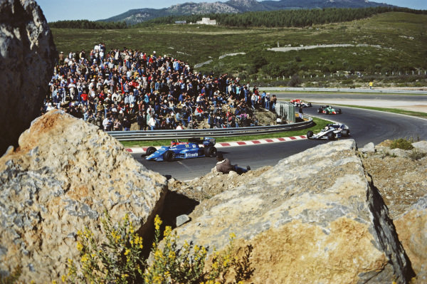 Piercarlo Ghinzani, Osella FA1F Alfa Romeo, leads Nelson Piquet, Brabham BT53 BMW.
