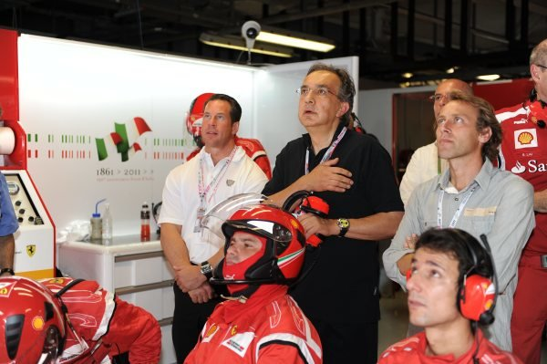 Sergio Marchionne in the garage with racing driver, Luca Badoer.