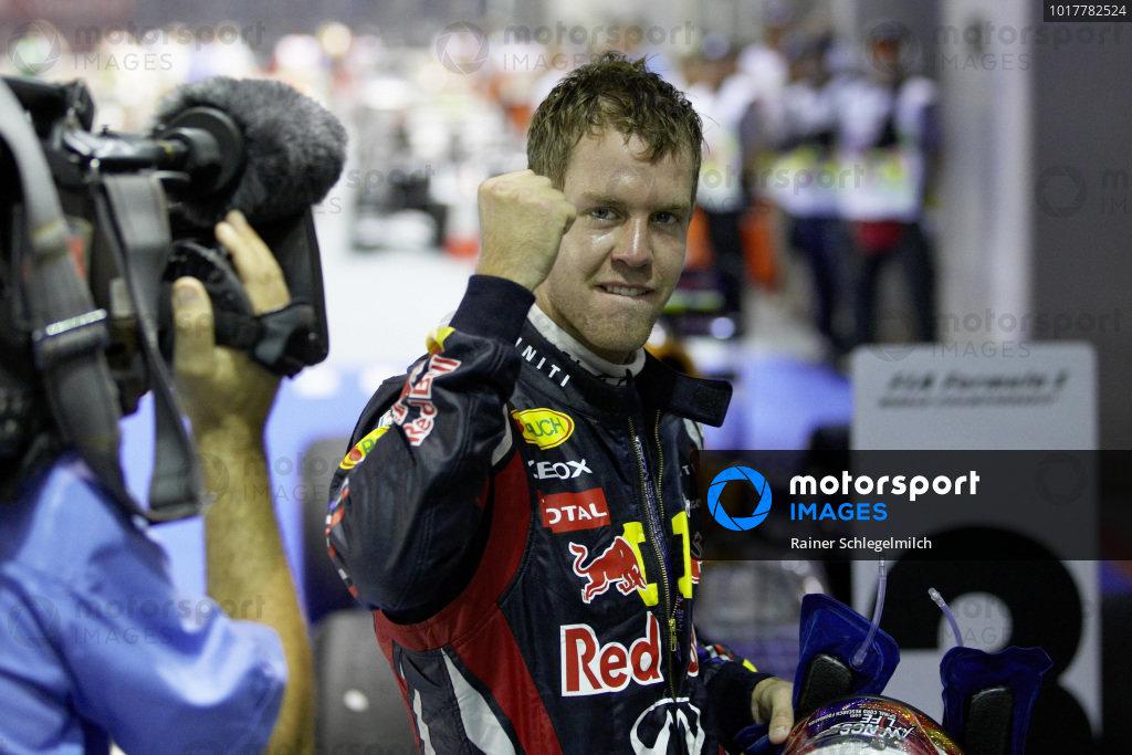 Sebastian Vettel celebrates in Parc Ferme.