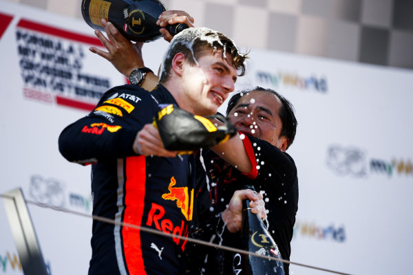 Toyoharu Tanabe, F1 Technical Director, Honda, and Max Verstappen, Red Bull Racing, 1st position, celebrate on the podium