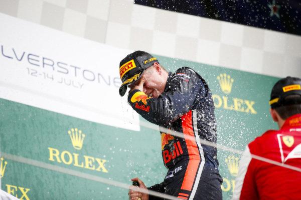 Race winner Juri Vips (EST) Hitech Grand Prix celebrates on the podium with the champagne