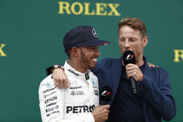 Silverstone, Northamptonshire, UK.  Sunday 16 July 2017. Lewis Hamilton, Mercedes AMG, 1st Position, is interviewed by Jenson Button, McLaren, on the podium. World Copyright: Glenn Dunbar/LAT Images  ref: Digital Image _X4I8337
