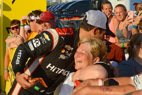 Verizon IndyCar Series Iowa Corn 300 Iowa Speedway, Newton, IA USA Sunday 9 July 2017 Winner Helio Castroneves, Team Penske Chevrolet hugs a fan in Victory Lane. World Copyright: F. Peirce Williams LAT Images