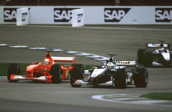 Indianapolis, Indiana, USA. 22-24 September 2000.Michael Schumacher (Ferrari F1-2000) passes David Coulthard (McLaren MP4/15 Mercedes) to take the lead. They finished in 1st and 5th positions respectively.Ref-2k USA A37.World Copyright - Coates/LAT Photographic