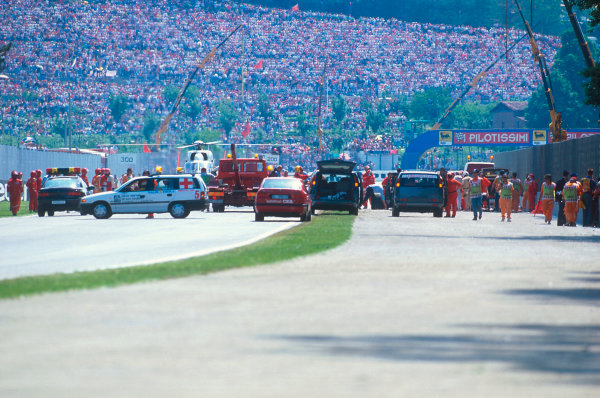 Imola, Italy.29/4-1/5 1994.Ayrton Senna's tradgic and untimely fatal accident. Here the race had been stopped and medical staff were treating him. The air ambulence then took him to hospital.Ref-94 SM 09.World Copyright - LAT Photographic