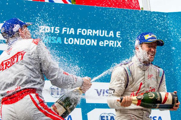 2014/2015 FIA Formula E Championship. London e-Prix, Battersea Park, London, UK. Sunday 28 June 2015. Sam Bird (GBR)/Virgin Racing - Spark-Renault SRT_01E and Jerome D'Ambrosio (BEL)/Dragon Racing - Spark-Renault SRT_01E on the podium World Copyright: Zak Mauger/LAT Photographic/Formula E. ref: Digital Image _MG_0218
