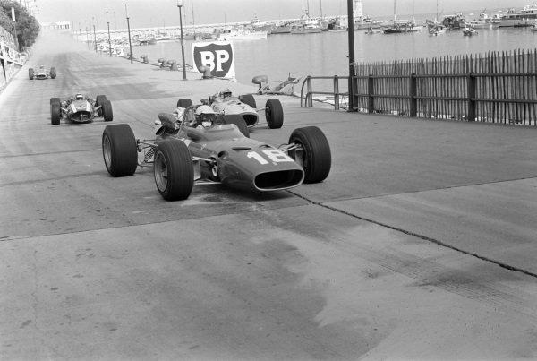Lorenzo Bandini, Ferrari 312, leads John Surtees, Honda RA273, and Jochen Rindt, Cooper T81B Maserati at Tabac corner.