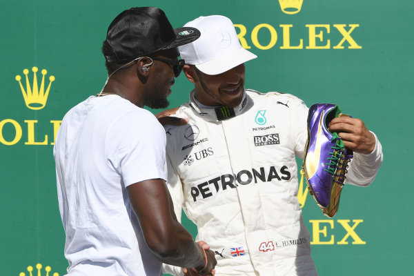 Race winner Lewis Hamilton (GBR) Mercedes AMG F1 celebrates on the podium with  Usain Bolt (JAM) at Formula One World Championship, Rd17, United States Grand Prix, Race, Circuit of the Americas, Austin, Texas, USA, Sunday 22 October 2017.