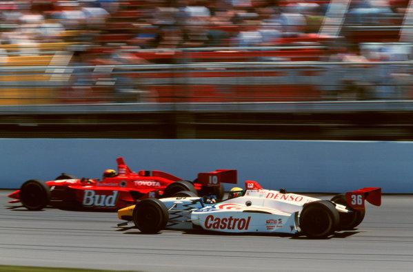 1999 CART Nazareth GP, 5/2/99, Nazareth, PennsylvaniaUSA.Alex Barron moves past Richie Hearn in a battle of Toyota powered machines.- 1999, Phillip Abbott, USA.LAT Photographic.