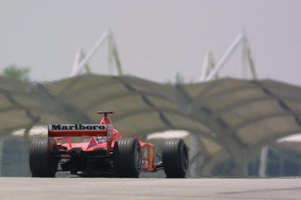 2001 Malaysian Grand Prix.Sepang, Kuala Lumpur, Malaysia. 16-18 March 2001.Michael Schumacher (Ferrari F2001) in action during Friday practice.World Copyright: Etherington / LAT Photographicref: 9mb digital image.