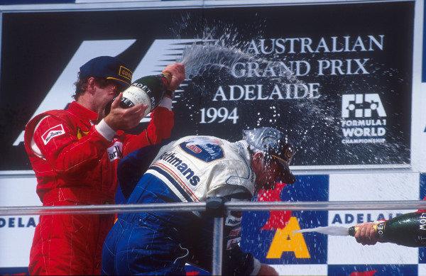1994 Australian Grand Prix.Adelaide, Australia.11-13 November 1994.Nigel Mansell (Williams Renault) 1st position gets sprayed with champagne on the podium. Gerhard Berger (Ferrari) 2nd position.Ref-94 AUS 09.World Copyright - LAT Photographic