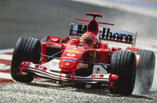 Michael Schumacher, Ferrari F2004, runs wide.