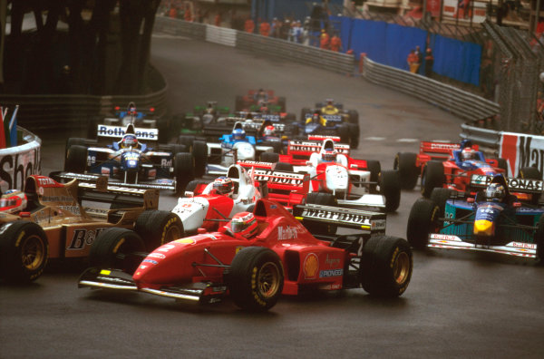 Monte Carlo, Monaco.16-19 May 1996.Eddie Irvine (Ferrari F310) at Ste. Devote with Rubens Barrichello (Jordan 196 Peugeot) going through on the inside and David Coulthard (McLaren MP4/11B Mercedes) following at the start.Ref-96 MON 08.World Copyright - LAT Photographic