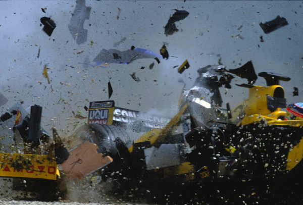 2002 Austrian Grand Prix.A1-Ring, Zeltweg, Austria.10-12 May 2002.The debris flies as Takuma Sato's Jordan EJ12 Honda chassis is ripped apart by the impact of Heidfeld's Sauber C21 Petronas which collided straight into his right hand side.Ref-02 AUT 05.World Copyright - LAT Photographic