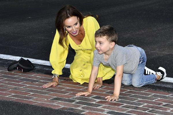 #18: Kyle Busch, Joe Gibbs Racing, Toyota Supra Combos, wife Samantha, son Brexton