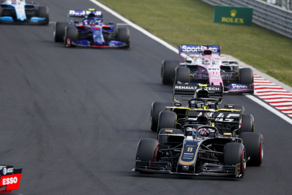 Romain Grosjean, Haas VF-19, leads Nico Hulkenberg, Renault R.S. 19, Sergio Perez, Racing Point RP19, and Alexander Albon, Toro Rosso STR14