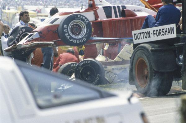 Mechanics recover Jonathan Palmer's Zakspeed 861, and an Arrows A8 BMW, following a collision.