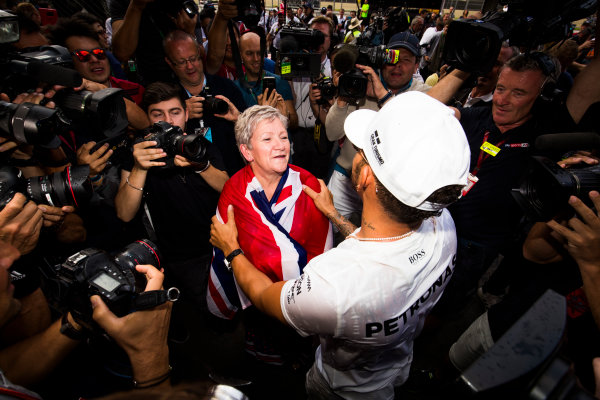 Autodromo Hermanos Rodriguez, Mexico City, Mexico. Sunday 29 October 2017. Lewis Hamilton, Mercedes AMG, celebrates his 4th world drivers championship title with his mother Carmen Larbalestier, surrounded by a large crowd of photographers. World Copyright: Sam Bloxham/LAT Images  ref: Digital Image _W6I1586