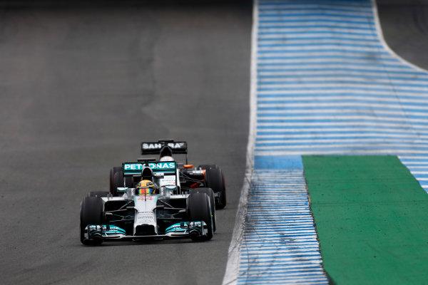 2014 F1 Pre Season Test 1 - Day 4 Circuito de Jerez, Jerez, Spain. Friday 31 January 2014. Lewis Hamilton, Mercedes W05 leads Adrian Sutil, Sauber C33 Ferrari. World Copyright: Andrew Ferraro/LAT Photographic. ref: Digital Image _79P7830.JPG
