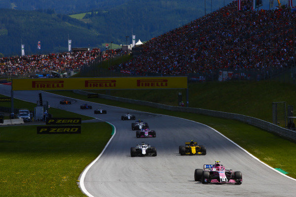 Esteban Ocon, Force India VJM11 Mercedes, leads Lance Stroll, Williams FW41 Mercedes, Carlos Sainz Jr., Renault Sport F1 Team R.S. 18, and Sergio Perez, Force India VJM11 Mercedes.