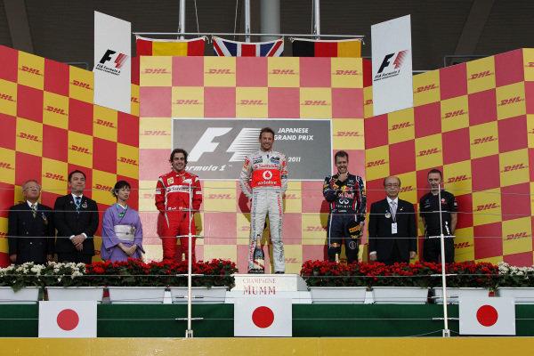The podium (L to R): Fernando Alonso (ESP) Ferrari, second; Jenson Button (GBR) McLaren, race winner; Sebastian Vettel (GER) Red Bull Racing, third and World Champion. Formula One World Championship, Rd 15, Japanese Grand Prix, Race, Suzuka, Japan, Sunday 9 October 2011.  BEST IMAGE