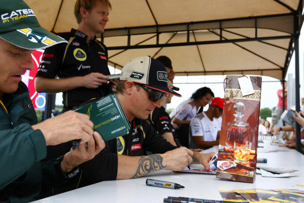 Hungaroring, Budapest, Hungary26th July 2012Kimi Raikkonen, Lotus GP isgn his autograph for fans.World Copyright:Charles Coates/LAT Photographicref: Digital Image _26Y9220