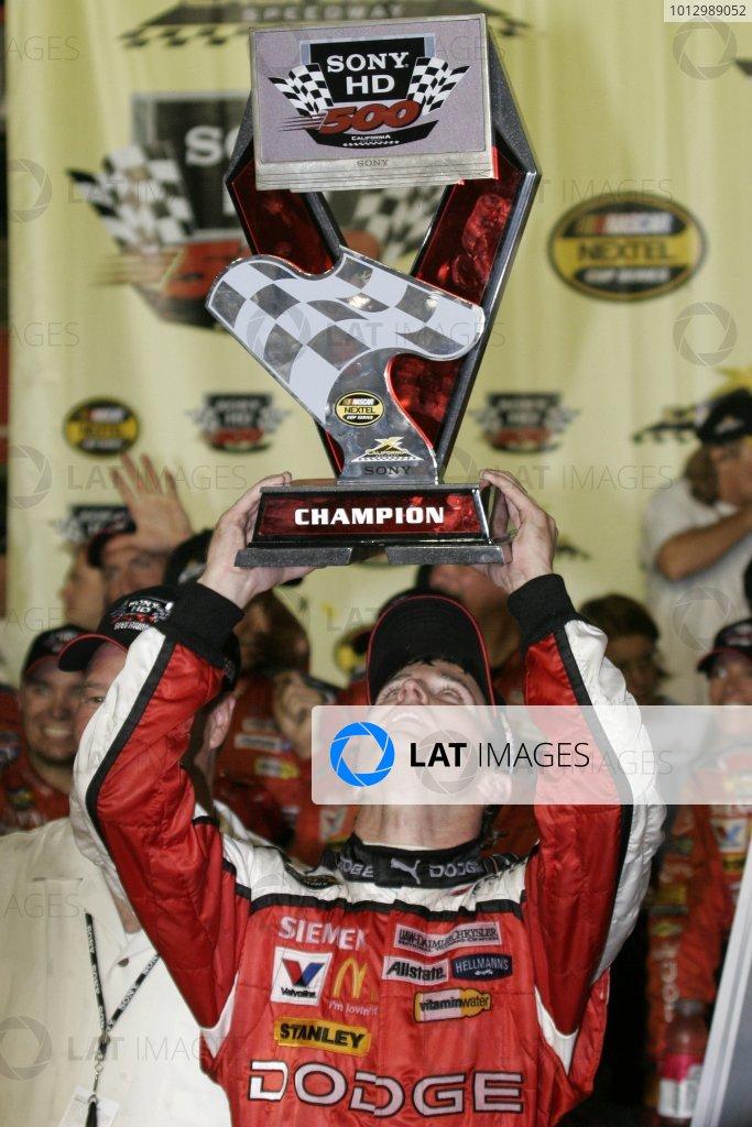 1-3 September 2006, California Speedway, Fontana, CA USAKasey Kahne admires his trophy(C) 2006 Lesley Ann Miller LAT Photographic USA
