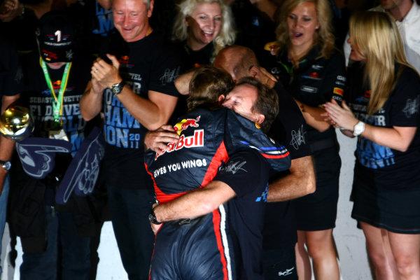 Suzuka Circuit, Suzuka, Japan.9th October 2011.Sebastian Vettel, Red Bull Racing RB7 Renault, 3rd position, is congratulated by Christian Horner, Team Principal, Red Bull Racing. Portrait. Atmosphere. World Copyright: Andy Hone/LAT Photographicref: Digital Image CSP25923