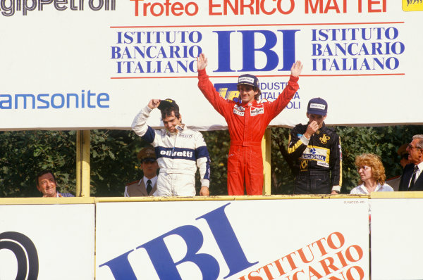 Monza, Italy. 6th - 8th September 1985.Alain Prost (McLaren MP4/2B-TAG Porsche) 1st position, celebrates with Nelson Piquet (Brabham BT54-BMW) 2nd position and Ayrton Senna (Lotus 97T-Renault) 3rd position, on the podium, portrait.World Copyright: LAT Photographic.Ref: 85ITA13