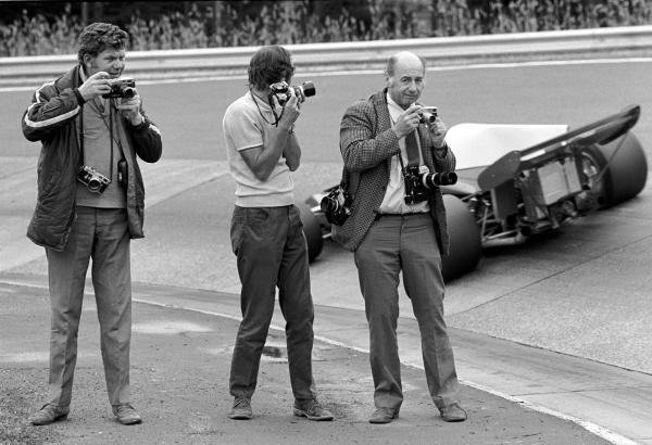 British Photographers, L to R: Maurice Rowe, Laurie Morton, and Geoff Goddard at the famous Karussell corner during practice German GP, Nurburgring, 1 August 1972