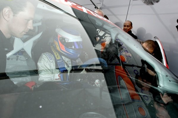 Lewis Hamilton (GBR), McLaren, and father Anthony Hamilton (GBR), watch Nicolas Hamilton (GBR), Total Control Racing, making his Renault Clio Cup racing debut this weekend. Renault Clio Cup, Rd1, Brands Hatch, England, 2 April 2011.