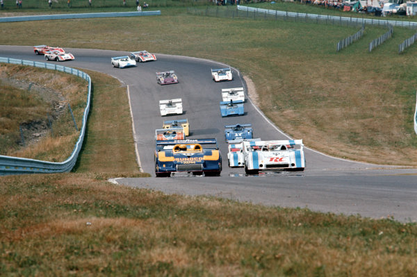 1973 Can-Am Challenge Cup. Watkins Glen, New York State, USA. 21 July 1973. Mark Donohue (Porsche 917/30KL) and George Follmer (Porsche 917/10K) lead at the start. Donohue finished in 1st position, action. World Copyright: LAT Photographic Ref: 35mm transparency 73CANAM03