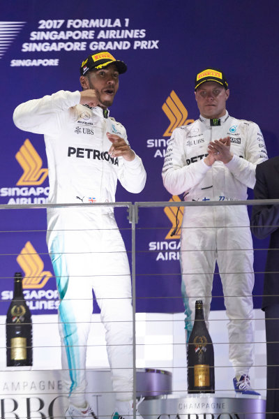 Marina Bay Circuit, Marina Bay, Singapore. Sunday 17 September 2017. Lewis Hamilton, Mercedes AMG, 1st Position, and Valtteri Bottas, Mercedes AMG, 3rd Position, on the podium. World Copyright: Steve Etherington/LAT Images  ref: Digital Image SNE17234