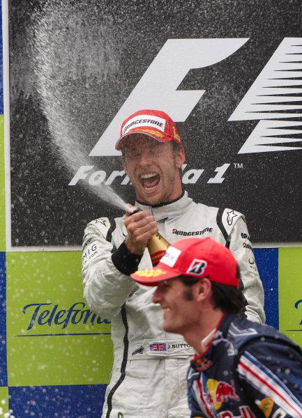 Circuit de Catalunya, Barcelona, Spain 10th May 2009 Jenson Button, Brawn GP BGP001 Mercedes, 1st position, and Mark Webber, Red Bull Racing RB5 Renault, 3rd position, celebrate on the podium. Portrait. Podium.  World Copyright: Steve Etherington/LAT Photographic ref: Digital Image SNE13980