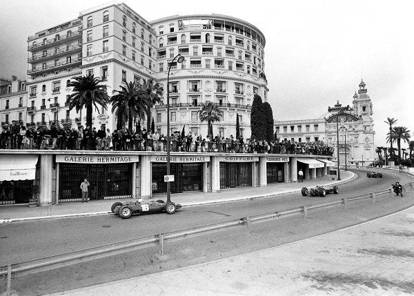 1965 Monaco Grand Prix.Monte Carlo, Monaco. 30th May 1965.Lorenzo Bandini (Ferrari 158 #18) follows two cars into Massenet corner. Spectators watch from above the Gallerie Hermitage shops.World Copyright LAT PhotographicPublished Autocar 04/06/65