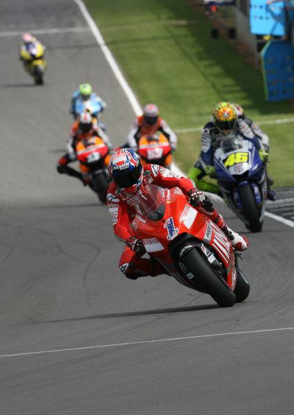 Donington Park, England. 22nd June 2008.MotoGP Race.Casey Stoner Ducati Marlboro Team leads Valentino Rossi Fiat Yamaha Team and the rest of the pack at the start of lap 3.World Copyright: Martin Heath/ LAT Photographicref: Digital Image