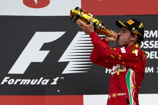 Hockenheimring, Hockenheim, Germany 22nd July 2012 Fernando Alonso, Ferrari, 1st position celebrates on the podium. World Copyright: Steve Etherington/LAT Photographic ref: Digital Image HC5C5973 copy