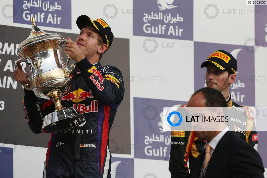 Bahrain International Circuit, Sakhir, Bahrain Sunday 21st April 2013 Sebastian Vettel, Red Bull Racing, 1st position, lifts his trophy. World Copyright: Andy Hone/LAT Photographic ref: Digital Image HONZ3035