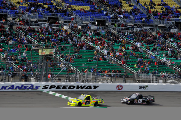 19-20 April, 2013, Kansas City, Kansas USA Matt Crafton at the finish line crosses under the checkered flag for the win followed by Joey Coulter ©2013, Scott R LePage LAT Photo USA