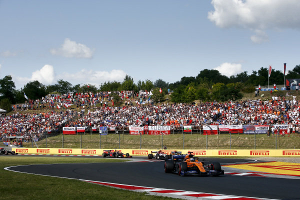 Carlos Sainz Jr., McLaren MCL34, leads Lando Norris, McLaren MCL34, Kimi Raikkonen, Alfa Romeo Racing C38, and Pierre Gasly, Red Bull Racing RB15
