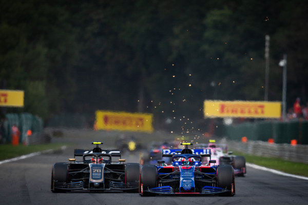 Pierre Gasly, Toro Rosso STR14, battles with Kevin Magnussen, Haas VF-19